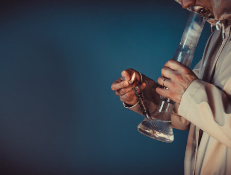 the-person-smoking-marijuana-with-bong-close-up-bong-in-the-hand_t20_1QWjkO